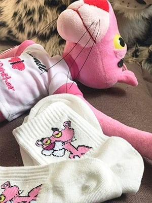 white pink panther socks with pink panther in background