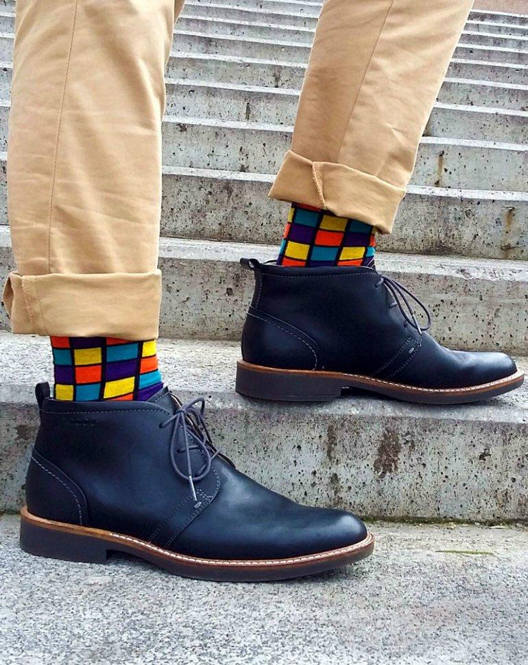 outfit idea for men with brown pants and funny socks