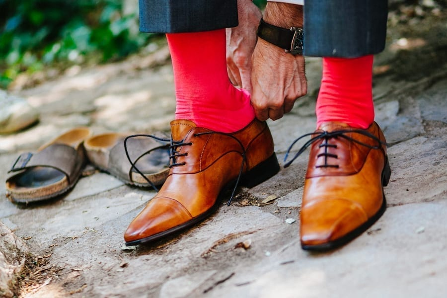 wearing red socks in formal outfit